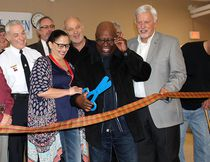 A good laugh was enjoyed by all when it was realized this large pair of plastic scissors wasn't going to allow the official ribbon cutting for the Chatham Hope Haven to proceed during a grand opening event held for the men's shelter in Chatham, Ont. on Monday February 19, 2018. Ellwood Shreve/Chatham Daily News/Postmedia Network