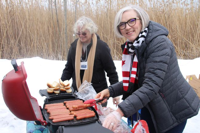 Volunteers Suzanne Plousos, left, and Cathy Cooper cooked up some hot dogs for the hundreds of people who came out to the Summerstown Trails for Family Day.