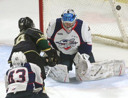 London Knights forward Liam Foudy rings a shot off the post on Windsor Spitfires goalie Michael DiPietro as the Spitfires' Louka Henault defends during an Ontario Hockey League game Monday at Budweiser Gardens. The Knights won 3-1. (MIKE HENSEN, The London Free Press)