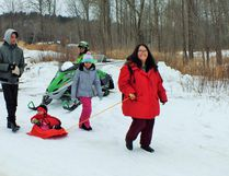 A young family makes their way to the lake to do some ice fishing. Photos by Leslie Knibbs/For The Mid-North Monitor