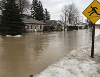 Flooding caused by heavy rain has closed roads and left some homes partly submerged in Port Bruce, south of St. Thomas. (Derek Ruttan/The London Free Press)