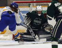 Nipissing Lakers goalie Jackie Rochefort makes one of 20 saves against the Ryerson Rams at Memorial Gardens, Wednesday. Ryerson won 4-2 with an empty-netter giving them the lead in their best-of-three OUA women's hockey quarterfinal series. Game two is in Toronto Friday night and game three, if the Lakers win, back at the Gardens Sunday night. Dave Dale / The Nugget