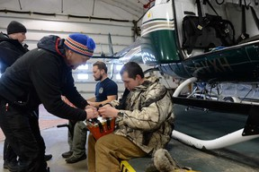 Caribou consultant Serge Couturier helps Chayse Penno pack the net in preparation for the translocation of caribou to Caribou Island from Michipicoten Island. The two were getting equipment ready in the Wilderness Helicopter hangar at Wawa airport. Couturier's assistant, Alex Gernier (back left), and Wilderness pilot, Danny Mercer (back right), were also part of the team involved in the project to preserve the threatened species.