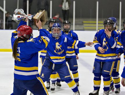 BCI's Erika Bellamy hoists the trophy as the team celebrates a 2-0 win over Paris District High School to claim the high school girls hockey championship on Wednesday at the Wayne Gretzky Sports Centre. (Brian Thompson/The Expositor)