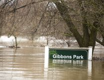 The Gibbons Park sign shows the depth of the flood waters in the park in London, Ont. Photograph taken on Wednesday February 21, 2018. Mike Hensen/The London Free Press/Postmedia Network