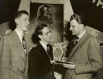 Evangelist Billy Graham (right), who died Wednesday at age 99, spoke in Chatham on Jan. 27, 1949 in the auditorium of the former Chatham Vocational School. With him in this photograph were Leighton Ford and Dan Goldsmith, both of Chatham. Ford would become an evangelist and at one time the head of the Billy Graham Evangelistic Association in Canada; he would also marry Graham's younger sister, Jean. Goldsmith would become a Christian pastor. Handout/Postmedia Network