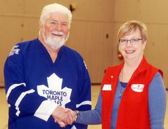 Gerry Flynn is congratulated by Canadian Blood Services volunteer Patty Henderson for donating blood for his 150th time last month.