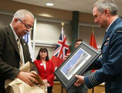 Tim Miller/The Intelligencer 8 Wing Commanding Officer Col. Mark Goulden receives a gift from Coun. David McCue at council on Tuesday in Quinte West.