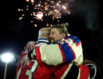 Brent Saik (right) hugs James McCormack as the World's Longest Hockey Game comes to a close at Saikers' Acres in Strathcona County on Monday, Feb. 19. Photo by David Bloom/Postmedia Network
