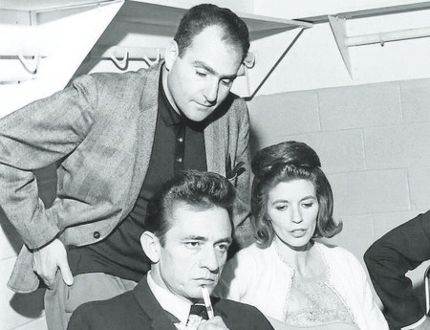 London's Saul Holiff is shown with Johnny Cash and June Carter Cash. Holiff managed the country star from 1960 to 1973. (File photo)