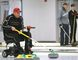 Elmer Stang doesn't let his MS keep him off the ice as he takes part in Saturday's sturling bonspiel, which featured a wide range of participants from old folks needing to use a stick to throw the rock to young adults still able slide down the ice.