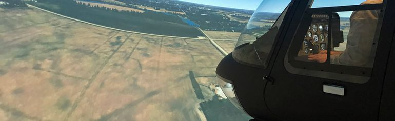 Peter Fedak flys the simulator over Portage la Prairie from the comfy confines of Hangar 1 at Southport. (Aaron Wilgosh/The Graphic)