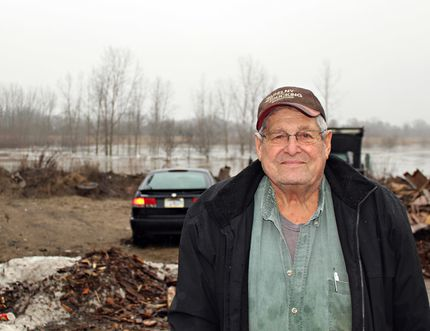 Alex Zahrybelny, who has been living on River Road for almost 80 years, takes in stride regular flooding of the Grand River. Much of his property remained underwater on Friday after this week's flood. (Michelle Ruby/The Expositor)