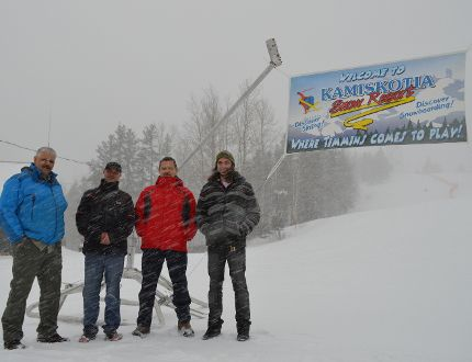 While there was no need to make snow on Friday, with several centimetres falling throughout the afternoon, man-made snow was essential in getting Kamiskotia Snow Resort open early in December. New machines donated by Kidd Operations helped make snow more efficiently. Standing next to the new equipment, from left, are board vice chair Yves Lamothe, board chair Rick Rusenstrom, Kidd Operations general manager Steve Badenhorst and hill general manager Eric Philipow.