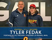 Tyler Fedak (right) poses for a photo after committing to the Queen's University Gaels. He'll be playing as a freshman next season and reports to camp Aug. 11. (Supplied Photo)