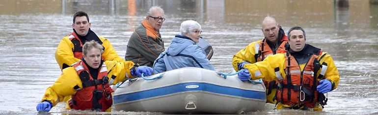 Chatham firefighters take an elderly man and woman to safety after flood waters ravaged Chatham on Saturday. LOUIS PIN / POSTMEDIA NETWORK