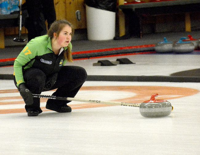 Sudbury skip Bella Croisier puts down the broom to give second Lauren Rajala a target to shoot for during the eighth end of a game against Smooth Rock Falls' Anaik Cloutier rink during the third draw of the U18 East Qualifier at the McIntyre Curling Club on Saturday. Croisier's foursome went on to post an 8-3 victory en route to compiling a perfect 3-0 record and earning a berth into the provincials.  THOMAS PERRY/THE DAILY PRESS