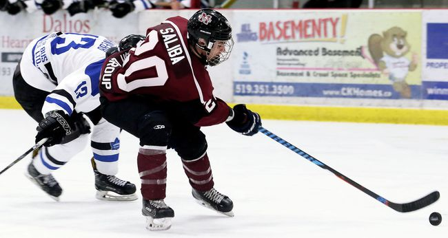Chatham Maroons' Alixe Saliba (20) is chased by London Nationals' Mitchell Webb (13) in the third period at Chatham Memorial Arena in Chatham, Ont., on Sunday, Feb. 25, 2018. (MARK MALONE/Chatham Daily News/Postmedia Network)