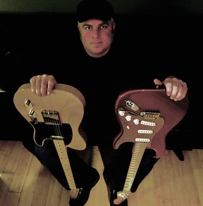 Four Barrel Blues Band's Chris Jenniskens shows off a pair of six-strings. The band will be playing during First Friday festivities at Cheeky Monkey on Mar. 2.  Handout/Sarnia This Week