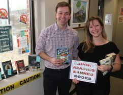 <p>Nicholas Seguin, communications and marketing co-ordinator for the SD&G County Library, and Morrisburg Branch library services assistant Stacey Piticco, at one of the Freedom to Read Week displays. Seen on Monday, February 26, 2018, in Morrisburg, Ont. </p><p> Todd Hambleton/Cornwall Standard-Freeholder/Postmedia Network