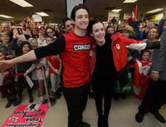 Scott Moir and Tessa Virtue are welcomed by their excited fans after arriving at London International Airport Monday from the Winter Olympics where they won gold in the ice dance competition. Hundred greeted Moir, of Ilderton, and Virture, of London, who took the time to pose for photos and sign autographs for the crowd. (MORRIS LAMONT/THE LONDON FREE PRESS)