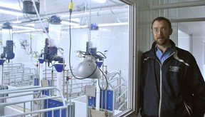 Paul Luimes, a livestock nutrition college research professor at the Ridgetown Campus of the University of Guelph, speaks about the farrowing room while providing a tour of the campus' new swine barn on Feb. 21. Tom Morrison/Chatham This Week