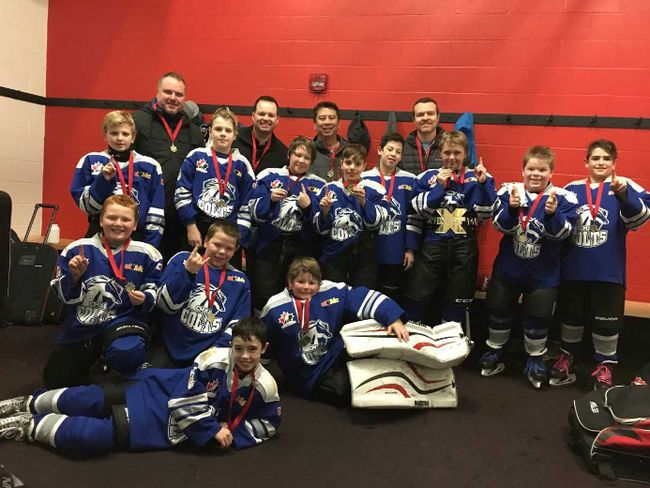 The Cornwall atom Colts won silver and gold in back-to-back tournaments. In front, from left, are Sheldon Vincent, Emile Beaulieu, Dylan Gillespie (laying down) and Colton Rheaume (goaltender). Standing are Matt Lewis, Caleb Barnes, Kaleb Ivens, Cayden Labrecque, Miguel Bernal, Kaleb Martin, Antoine Beaulieu and Stanton Antoine. At back are coached Brian Vincent, Dan Rheaume, Tony Bernal and Ian Gillespie.