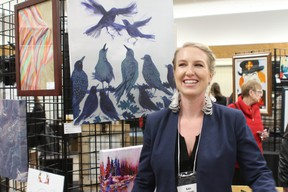 Kate Kennedy pictured with her acrylic canvas painting 'Jazz Hands.' Kate graduated from Emily Carr University in Vancouver and displayed four paintings at the show for her fourth year showing.