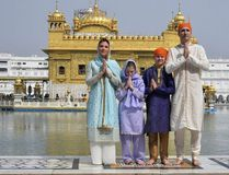 Canadian Prime Minister Justin Trudeau, right, his wife Sophie Gregoire Trudeau, left, their daughter Ella Grace, second left, and son Xavier greet in Indian style during their visit to Golden Temple, in Amritsar, India, Wednesday, Feb. 21, 2018. Public Relations Office Govt. Of Punjab / AP
