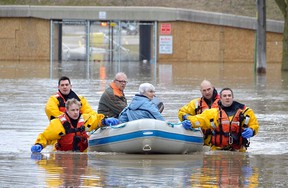 Members of the Chatham-Kent Fire & Services dive team arrived on scene at the Siskind and Pegley Court area of Chatham, Ont. on Saturday, Feb. 24 to assist some residents whose homes were flooded. Louis Pin/Postmedia Network