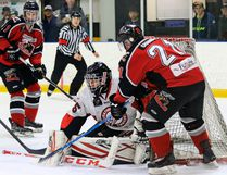 Ryan Chambers of the Blackfalds Wranglers tries to slip a puck past Airdrie Techmation Thunder goaltender C.J. Wedenig during Game 4 of the HJHL north division semifinal at the Blackfalds Multi-plex Arena on Tuesday night. (Ashli Barrett/Lacombe Globe)