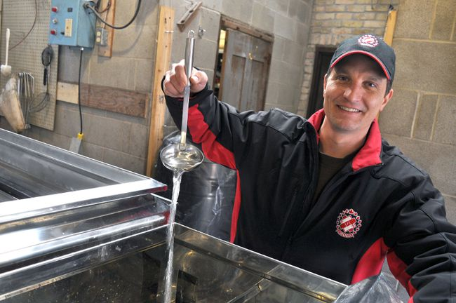 Darryl Van Moorsel, a volunteer sap boiler at Kinsmen Fanshawe Sugar Bush, recently fired up the evaporator for the first time this season. (CHRIS MONTANINI, The Londoner)