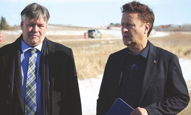 Portage MLA and Minister of Education and Training, Ian Wishart (left) and Infrastructure Minister Ron Schuler (right) announced the replacement of the Hwy 1A bypass in Portage la Prairie Thursday afternoon. (Brian Oliver/The Graphic)