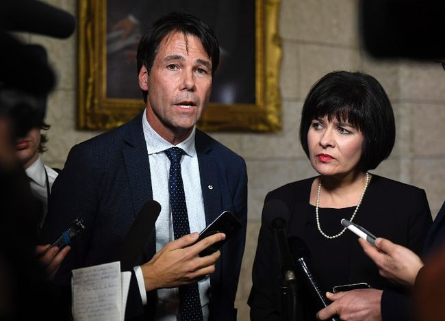 Minister of Health Ginette Petitpas Taylor stands with Eric Hoskins, former Ontario Minister of Health, after the tabling of the budget in the House of Commons on Parliament Hill in Ottawa on Tuesday, Feb. 27, 2018. Hoskins will chair a federal government advisory council to implement a national pharmacare plan. THE CANADIAN PRESS