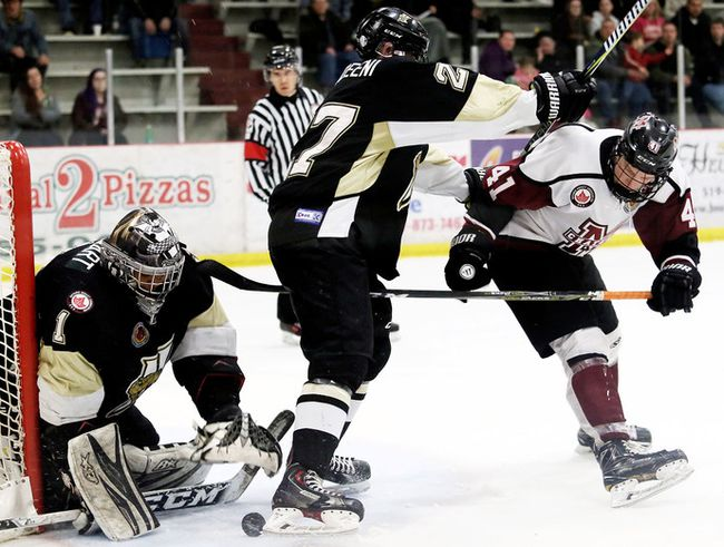 Chatham Maroons' Dane Johnstone (41) is hit by LaSalle Vipers' Abdul Abouzeeni (27) as Vipers goalie Dershahn Stewart makes a save in the third period at Chatham Memorial Arena in Chatham, Ont., on Thursday, March 1, 2018. (MARK MALONE/Chatham Daily News/Postmedia Network)