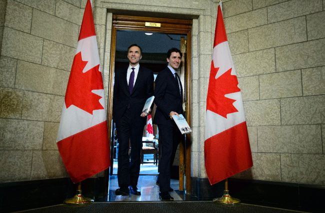 Minister of Finance Bill Morneau walks with Prime Minister Justin Trudeau as they leave his office on route to deliver the federal budget in the House of Commons on Parliament Hill in Ottawa on Tuesday, Feb. 27, 2018. (THE CANADIAN PRESS/Sean Kilpatrick)