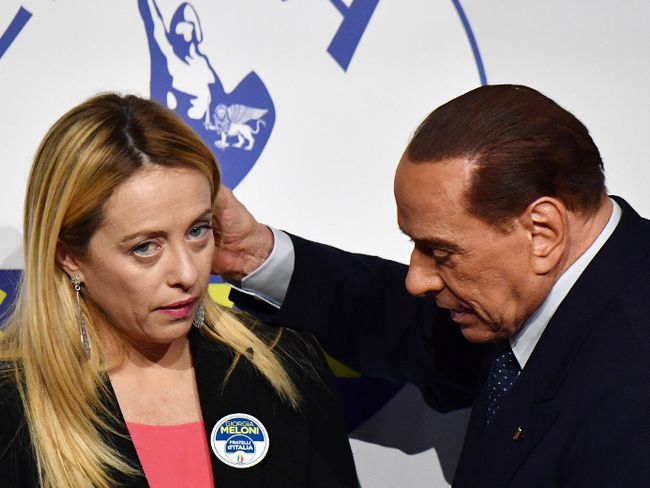 Leader of Italian right-wing party Forza Italia Silvio Berlusconi, right embraces Giorgia Meloni, president of Brothers of Italy party, at the end of a joint press conference in Rome on Thursday. (ALBERTO PIZZOLI/AFP/Getty Images)