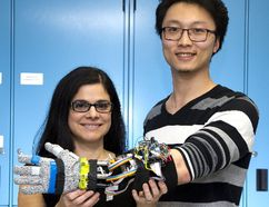 Engineering professor Ana Luisa Trejos and student Yue Zhou demonstrate a tremor suppression glove developed at Western University. The device offers people with Parkinson's disease improved motor control. (Derek Ruttan/The London Free Press)