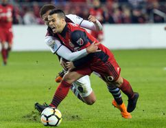 Colorado Rapids Kortne Ford (left) wrestles Toronto FC's Sebastian Giovinco to the ground during second half CONCACAF Champions League Round of 16 action in Toronto on Tuesday, Feb. 27.