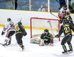 Alec DeKoning (No. 22 in white) scores the winning goal with a backhand shot to give the Sarnia Legionnaires a 4-3 win over the St. Thomas Stars during Jr. 'B' playoff action Sunday at Sarnia Arena. (Submitted photo by Shawna Lavoie)