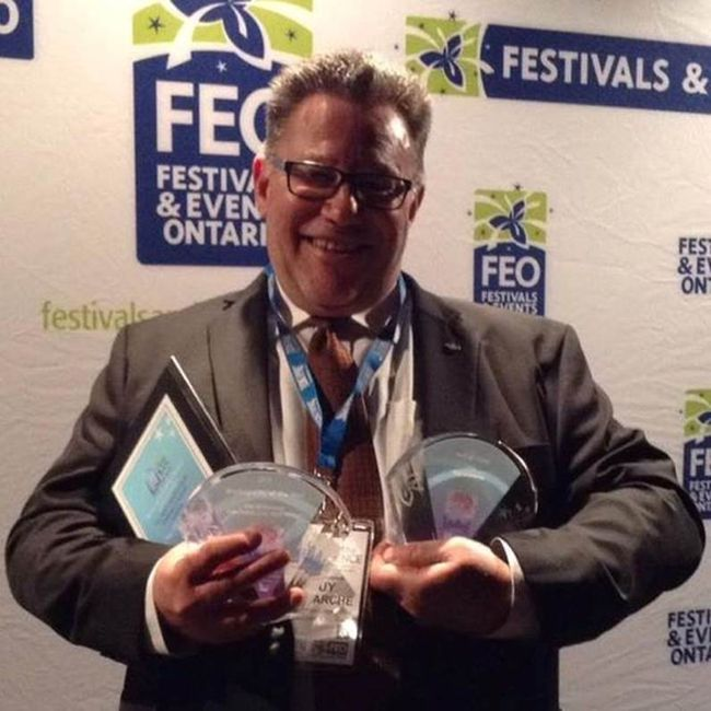 Manager of tourism and events Guy Lamarche holds a trio of awards won by Tourism Timmins at a Festivals & Events Ontario awards ceremony in Hamilton on Friday evening.