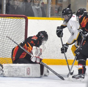 Logan Harmer of the Mitchell Bantams looks for the puck in close against Penetang during Game 1 of their OMHA 'B' semi-final series Feb. 24. Harmer scored twice in Game 2 in a 3-2 victory but Pentang won in overtime in Game 3, 2-1. ANDY BADER/MITCHELL ADVOCATE