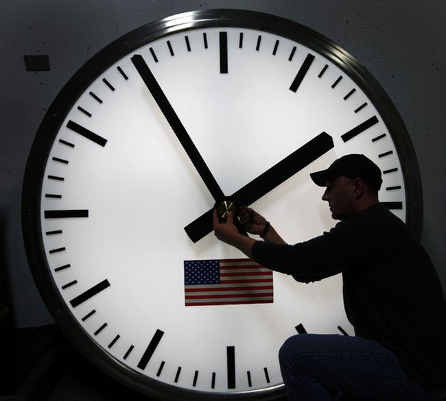 <p>Dave LeMote uses an allen wrench to adjust hands on a stainless steel tower clock at Electric Time Company, Inc. in Medfield, Mass., in this March 7, 2014 file photo.</p><p>  AP Photo/Elise Amendola, File