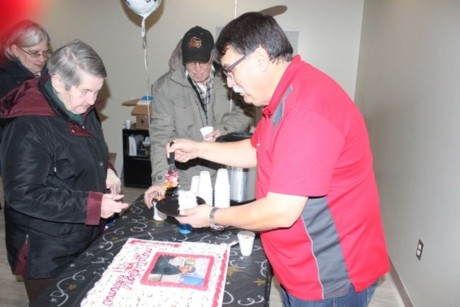 Al Parenteau was serving retirement cake on his last day with Prairie North Co-op on March 2. he is retiring after nearly 40 years with the same company.