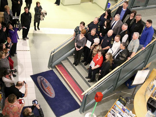 Tim Miller/The Intelligencer Volunteers line up on the stairs at city hall to have their picture taken on Monday in Trenton. Dozens of individuals were honoured for their volunteer work at Monday night's council meeting.