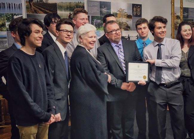 Ontario Lieutenant Governor Elizabeth Dowdeswell (centre) presents the Ontario Heritage Award certificate to St. Patrick's Catholic High School teacher Robert Walicki and students from his grade 11 Communications Technology class at a ceremony on Feb. 23. Handout/Sarnia This Week