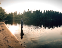 A man fishing at the Moose Lake reserve area appears in a still from a film produced by the Fort McKay First Nation and uploaded to Vimeo on November 14, 2017.