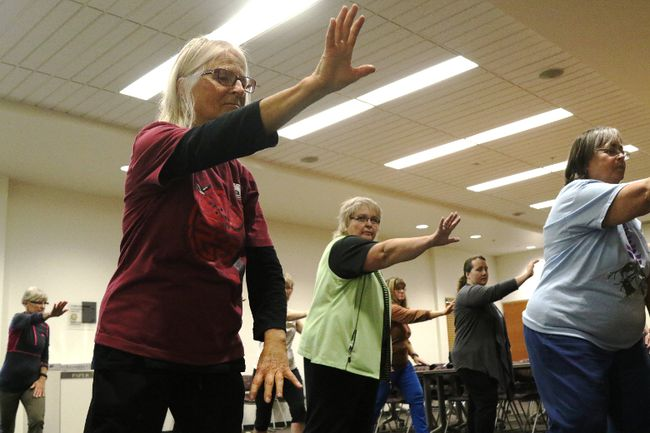 FILE PHOTO Elaine Nepstad (left) and other instructors from the Fung Loy Kok Taoist Tai Chi Grande Prairie branch lead a free demonstration class in celebration of Seniors' Week in the Rotary Community Room in 2017 in Grande Prairie.
