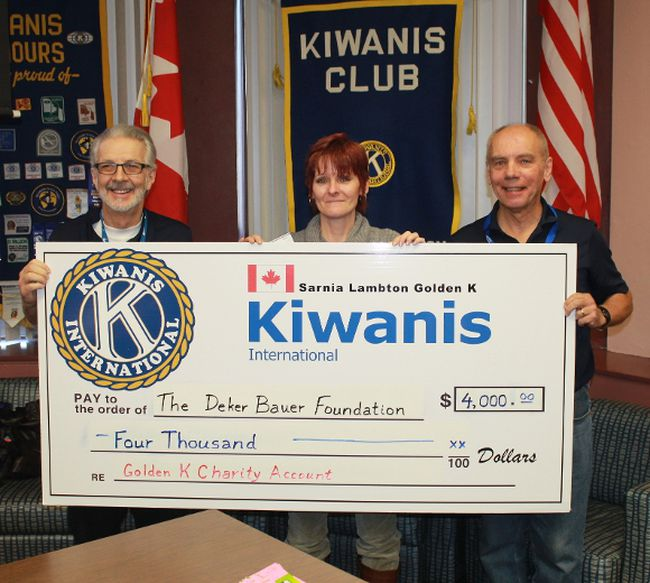 Deker Bauer Foundation CEO Teresa Ingles receives a cheque for $4,000 from Sarnia-Lambton Golden K Kiwanis members Dick Felton and Allan McKeown following her Feb. 27 presentation.
