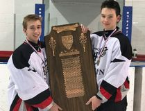 The Holy Trinity Titans boys hockey team won the school's first ever CWOSSA A/AA title on Tuesday in Kincardine. Accepting the championship plaque are Spencer Kowalsky and Cole Robinson. Contributed Photo